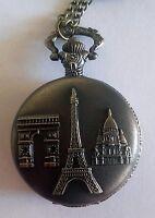 Superbe montre pendentif ronde décor monuments parisiens métal jaune neuve