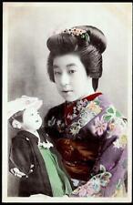 Japan c.1907-c.1910's - Geisha, Young Eiryō II Holding a Doll studio posed H/c