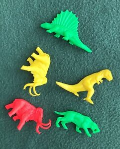 vintage 1970s little plastic dinosaurs Woolly Mammoth Sabertooth Tiger peg toys