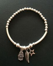 Sterling Silver Beaded Noodle Tube Stretch Bracelet. Angel Wing Star And Hamsa