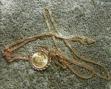 22,18,and 14 KARAT GOLD PENDANT NECKLACE