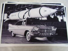 1957 PLYMOUTH FURY AND SPACE ROCKET  11 X 17  PHOTO  PICTURE