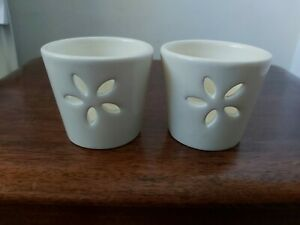 Pair of  cream ceramic Tea Light Holders with cut out flower pattern. 5.5cm tall