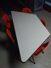 "Trapezoid Activity Tables - 30"" X 60"", Mobile - brown with chairs set used"