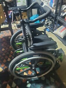 Jay Zip pediatric wheelchair black and green with tilt and cushion
