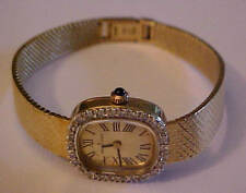 UNIVERSAL GENEVE LADIES SOLID 14KT & DIAMOND BEZEL ROMAN DIAL QUARTZ WRIST WATCH