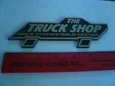 The Truck Shop Adrian Mi & Toledo Ohio Name Plate Emblem Dealership Script