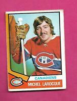 1974-75 OPC # 297 CANADIENS MICHEL LAROCQUE ROOKIE CREASED CARD (INV# D2663)