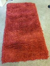 red oblong shaggy rug 60cm x 120cm