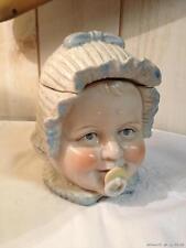 Bonbonnière / boîte en faïence tête de bébé à bonnet bleu