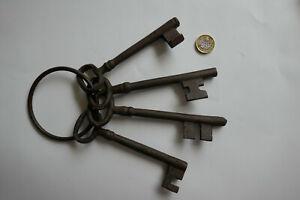 Bunch of 4 Antique Large Iron Keys on their Original Large Iron Ring