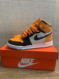 orange and black nike high tops