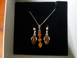 Beautiful sterling  Silver and real amber necklace and earrings