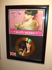 KATY PERRY   SIGNED  GOLD  DISC  Y