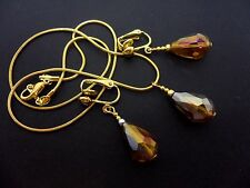 A  GOLD TONE AMBER GLASS CRYSTAL TEARDROP NECKLACE & CLIP ON EARRING SET. NEW.