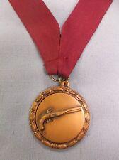 bronze metal insert gun medal maroon neck drape