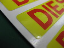 2 DIESEL FUEL STICKERS RED TEXT ON YELLOW