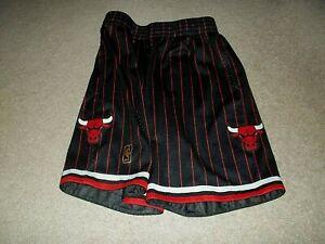 Mitchel & Ness Chicago Bulls Gold NBA Logo Hardwood Classics Drawstring Shorts