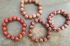 SET OF FOUR WOODEN BEAD PATTERNED BRACELETS