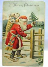 1907 POSTCARD MERRY CHRISTMAS,SANTA CLAUS WEARING SNOW SHOES, TOYS & TREE