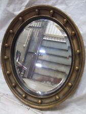 Regency gilt deep ball framed oval bevel edged wall mirror