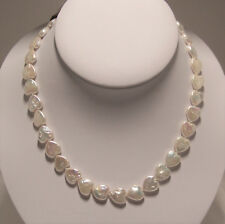 Hand strung heart shaped fresh water cultured pearl necklace .