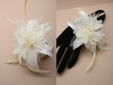 Cream feather and flower corsage on a 4 row pearl bead wristband - JTY142