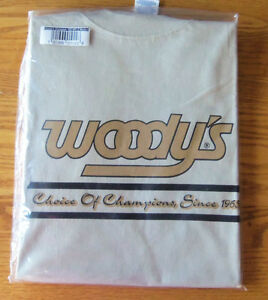 MENS T-SHIRT MEDIUM TAN  WOODY'S STUD APPAREL CHOICE OF CHAMPOINS SINCE 1965 NEW