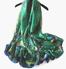 100%silk scarf/wrap. Beautiful peacock feather design. Xmas/gift wrap available.