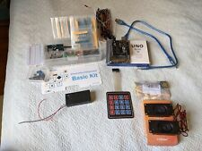 A bunch of Arduino stuff: Uno R3, Component Basic Kit, mp3 player, speakers.