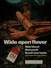 1974 Shirtless Man Lumberjack Logs L&M Cigarettes Photo Print Ad
