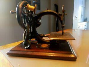 Willcox and Gibbs sewing machine - hand cranked - circa 1890