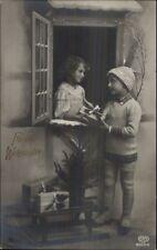 German Christmas - Boy Delivers Gift to Girl c1910 Real Photo Postcard