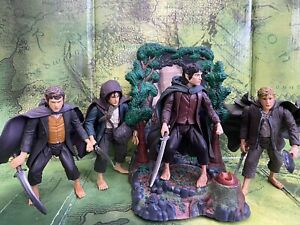 LORD OF THE RINGS LOOSE ACTION FIGURES-FRODO,SAM,MERRY  AND PIPPIN