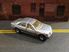 Matchbox 1:64 Scale 1992 Mercedes Benz SEL-600. Silver & Dark Beige.
