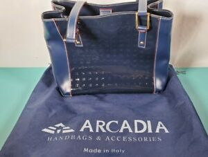 ARCADIA BLUE PATENT LEATHER LOGO EMBOSSED BAG W DUST BAG RED LEATHER TRIM