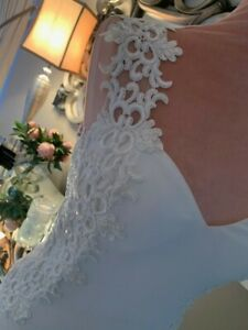 Elegant Ivory wedding dress size 10 with lace bodice detail & short train