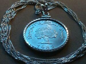 "1983 Tunisia Oak Tree Diamond Cut .925 Bezel Pendant on a 28"" Wavy silver chain."