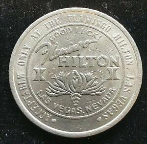 Casino $1 metal token 1987 FLAMINGO HILTON  Las Vegas gaming dollar 37mm