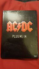 AC/DC Plug Me In With 2 Booklets Dvd