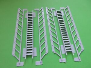 2  Staircases  with hand rails 100mm  x 45 degree can be cut to length 00 Gauge