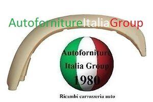 PARAFANGHINO ARCORUOTA MODANATURA ANTERIORE DX MITSUBISHI L200 96>05 1996>2005