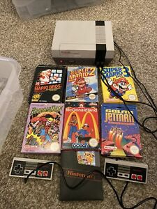 Nintendo NES Console, 7 Games With Original Boxes, 2 Controllers, All Cables.