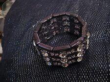 Wonderful elasticated cuff style bracelet with white stone decoration