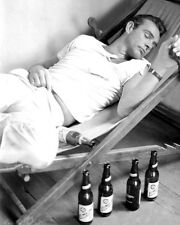 DR. NO JAMES BOND SEAN CONNERY RELAXING ON SET BY BEER BOTTLES 16X20 POSTER