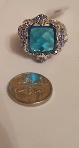Simulated Blue Topaz (Cush), Simulated Diamond Ring in Silver Plated. Size O.