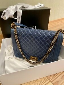 Authentic Chanel Boy flap chain shoulder bag,blue soft lambskin. Limited Edition