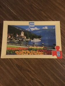 Oberhofen Castle Switzerland Tulips Flowers Water Mountains 2000 Piece Puzzle