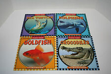 SET OF 4 LET'S READ ABOUT ANIMALS WEEKLY READER BOOKS DOLPHINS SEA TURTLES ETC.