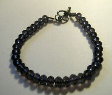 Bracelet with fab silver tone metal fitting and smokey faceted beads